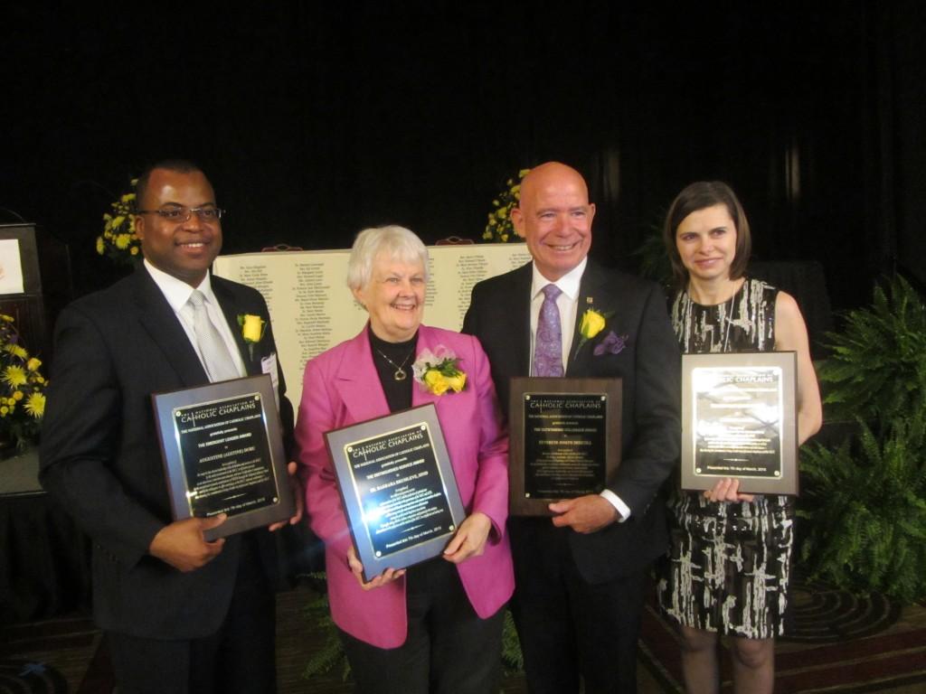The 2015 Award winners show off their plaques. L to R: Augustine Duru, Sr. Barbara Brumleve SSND, Rev. Joseph Driscoll, Caterina Mako.